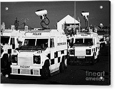Psni Surveillance Landrovers With Cameras On Crumlin Road At Ardoyne Shops Belfast 12th July Acrylic Print by Joe Fox