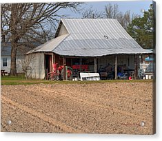 Red Tractor In A Tin Roofed Shed Acrylic Print by Paulette B Wright