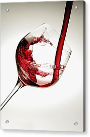 Red Wine Pouring Into A Glass Acrylic Print by Richard Desmarais