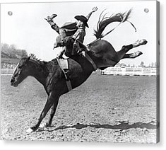 Riding A Bucking Bronco Acrylic Print by Underwood Archives