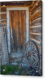 Rustic Door And Wagon Wheels Acrylic Print by Paul Freidlund