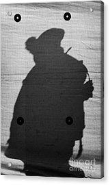 Silhouette Of British Army Soldier On Screen On Crumlin Road At Ardoyne Shops Belfast 12th July Acrylic Print by Joe Fox