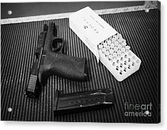 Smith And Wesson 9mm Handgun With Ammunition At A Gun Range Acrylic Print by Joe Fox