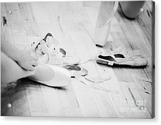 Students Putting On Pointe Shoes At A Ballet School In The Uk Acrylic Print by Joe Fox