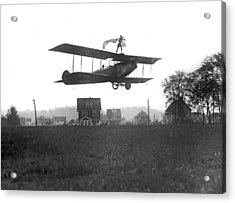 Stunts Atop A Biplane Acrylic Print by Underwood Archives