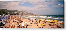 Tourists On The Beach, Sitges, Spain Acrylic Print by Panoramic Images