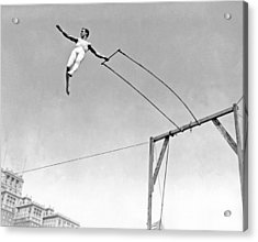 Trapeze Artist On The Swing Acrylic Print by Underwood Archives