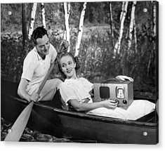 Two Lovers In A Canoe Acrylic Print by Underwood Archives
