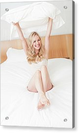 Woman Sitting On Bed Holding Pillow Acrylic Print by Ian Hooton