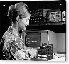 Woman Testing A Microcomputer Acrylic Print by Underwood Archives