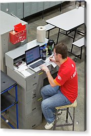 Worker Using Laptop In A Factory Acrylic Print by Jim West