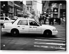 Yellow Cab Blurring Past Crosswalk And Pedestrians New York City Usa Acrylic Print by Joe Fox