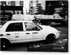 Yellow Cab With Advertising Hoarding Blurring Past Crosswalk And Pedestrians New York City Usa Acrylic Print by Joe Fox