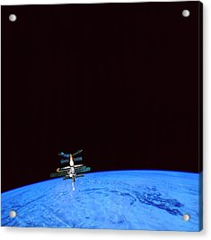 A Space Station Orbiting Above The Earth Acrylic Print by Stockbyte