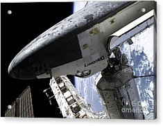 Space Shuttle Discovery Docked Acrylic Print by Stocktrek Images