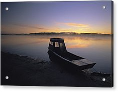 A Boat Sits On The Calm Yukon River Acrylic Print by Michael Melford