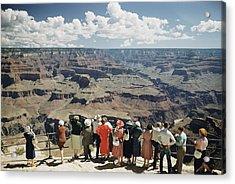 A Group Of Visitors At Hopi Point Acrylic Print by Justin Locke