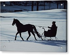 A Horse-drawn Sleigh Ride At Twilight Acrylic Print by Ira Block