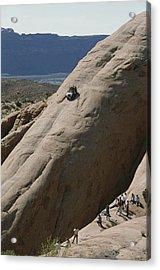 A Jeep Drives Down A Slick Rock Acrylic Print by James P. Blair