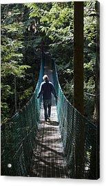 A Man Walks Across A Suspension Bridge Acrylic Print by Taylor S. Kennedy