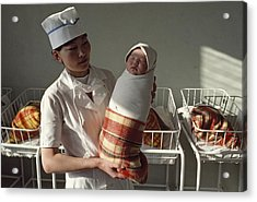 A Nurse Holds A Tightly Wrapped Newborn Acrylic Print by Dean Conger