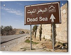 A Road Sign In Both Arabic And English Acrylic Print by Taylor S. Kennedy