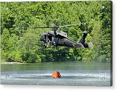 A Uh-60 Blackhawk Helicopter Fills Acrylic Print by Stocktrek Images