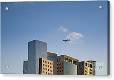 Airplane Flying Over Office Buildings Acrylic Print by Noam Armonn