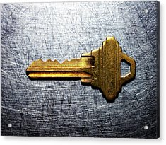 Brass Key On Stainless Steel. Acrylic Print by Ballyscanlon