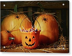 Bucket Filled With Halloween Candy Acrylic Print by Sandra Cunningham