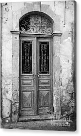 chained up wooden door to derelict house near the restricted area of the UN buffer zone Acrylic Print by Joe Fox