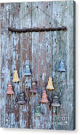 Clay Bells On A Weathered Door Acrylic Print by Jeremy Woodhouse