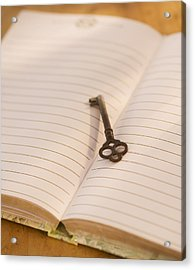 Close Up Of Open Notebook With Key, Studio Shot Acrylic Print by Daniel Grill