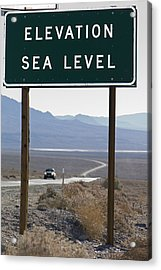 Elevation Sea Level Sign And Highway Acrylic Print by Rich Reid