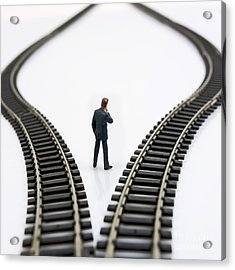 Figurine Between Two Tracks Leading Into Different Directions  Symbolic Image For Making Decisions Acrylic Print by Bernard Jaubert