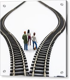 Figurines Between Two Tracks Leading Into Different Directions Symbolic Image For Making Decisions. Acrylic Print by Bernard Jaubert