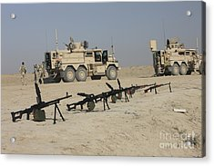 Firearms Sit Ready On A Firing Range Acrylic Print by Terry Moore