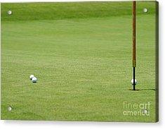 Golf Balls Near Flagstick Acrylic Print by Henrik Lehnerer