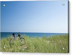 Grass Covering Bicycle Parked On Beach Dune. Acrylic Print by Alberto Coto