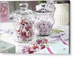 Jars Of Candies On Table Acrylic Print by Debby Lewis-Harrison