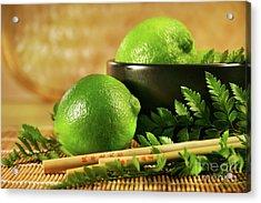 Limes With Chopsticks Acrylic Print by Sandra Cunningham