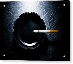 Lit Cigarette And Ashtray On Stainless Steel. Acrylic Print by Ballyscanlon