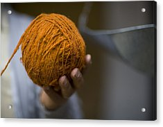 Mans Hand Holds Ball Of Orange Wool Acrylic Print by David Evans