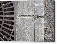 Metal Grate On Sidewalk Acrylic Print by Paul Edmondson