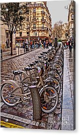 Paris Wheels For Rent Acrylic Print by Bob and Nancy Kendrick