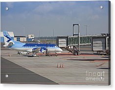 Parked Airplane At An Airport Gate Acrylic Print by Jaak Nilson