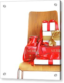 Pile Of Gifts On Wooden Chair Against White Acrylic Print by Sandra Cunningham