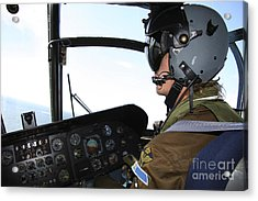 Pilot In The Cockpit Of A Ch-46 Sea Acrylic Print by Daniel Karlsson
