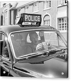 Police Camera Action Acrylic Print by Ken Harding