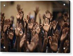 School Children Raise Their Hands Acrylic Print by Lynn Johnson